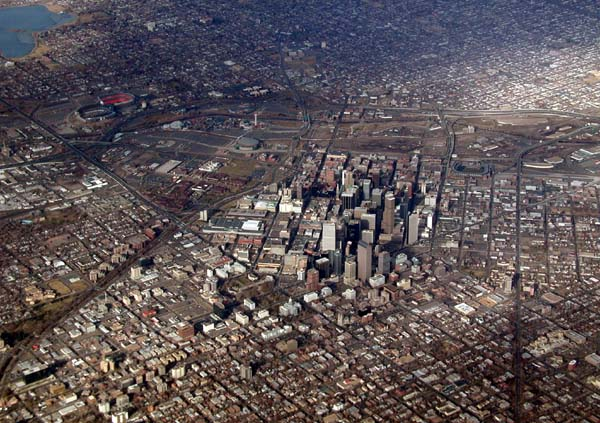 Aerial photograph of downtown Denver, showing the central business district and city grids running out in every direction.